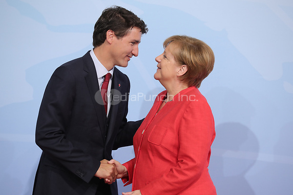German chancellor Angela Merkel greets the Canadian prime minister Justin Trudeau at the G20 summit in Hamburg, Germany, 7 July 2017. The heads of the governments of the G20 group of countries are meeting in Hamburg on the 7-8 July 2017. Photo: Michael Kappeler/dpa /MediaPunch ***FOR USA ONLY***