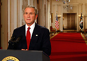Washington, D.C. - September 24, 2008 -- United States President George W. Bush poses for photographers moments after speaking to the nation from the White House September 24, 2008 in Washington, DC. President Bush spoke live to the American people about the current financial crisis. He also spoke about the bailout package currently being debated in Congress. <br /> Credit: Mark Wilson - Pool via CNP