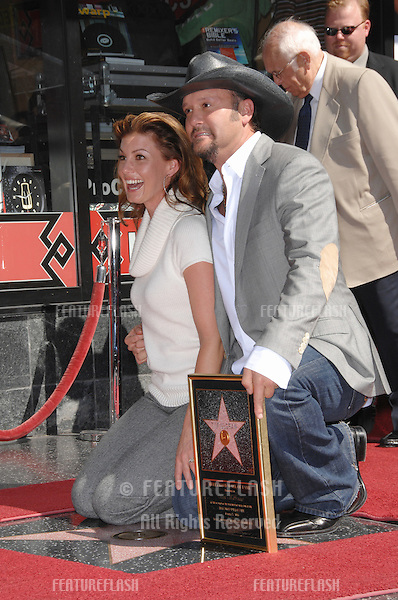 TIM McGRAW & wife FAITH HILL on Hollywood Boulverd where he was honoured with the 2,322nd star on the Hollywood Walk of Fame..October 17, 2006  Los Angeles, CA.Picture: Paul Smith / Featureflash