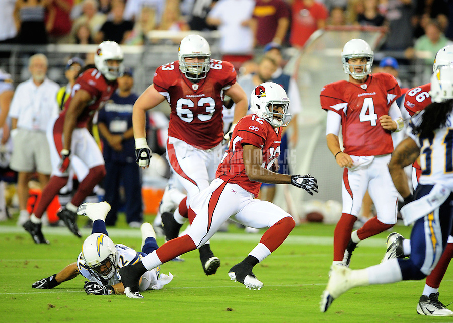 Aug. 27, 2011; Glendale, AZ, USA; Arizona Cardinals wide receiver (12) Andre Roberts runs for a third quarter touchdown against the San Diego Chargers during a preseason game at University of Phoenix Stadium. Mandatory Credit: Mark J. Rebilas-