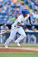 Asheville Tourists Daniel Montano (24) runs to first base during a game against the Charleston RiverDogs at McCormick Field on August 16, 2019 in Asheville, North Carolina. The Tourists defeated the RiverDogs 12-3. (Tony Farlow/Four Seam Images)