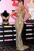 NEW YORK, NY - NOVEMBER 06: Victoria's Secret Angel Candice Swanepoel Shows Off The $10 Million Royal Fantasy Bra at Victoria's Secret Herald Square on November 6, 2013 in New York City. (Photo by Jeffery Duran/Celebrity Monitor)