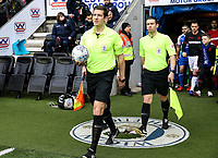 Referee Robert Jones leads the teams out at the DW Stadium <br /> <br /> Photographer Andrew Kearns/CameraSport<br /> <br /> The EFL Sky Bet Championship - Wigan Athletic v Bolton Wanderers - Saturday 16th March 2019 - DW Stadium - Wigan<br /> <br /> World Copyright &copy; 2019 CameraSport. All rights reserved. 43 Linden Ave. Countesthorpe. Leicester. England. LE8 5PG - Tel: +44 (0) 116 277 4147 - admin@camerasport.com - www.camerasport.com