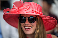 BALTIMORE, MD - MAY 20: A woman in a festive hat and Snapchat glasses smiles while in the grandstands on Preakness Stakes Day at Pimlico Race Course on May 20, 2017 in Baltimore, Maryland.(Photo by Scott Serio/Eclipse Sportswire/Getty Images)