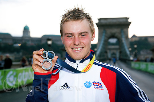 12 SEP 2010 - BUDAPEST, HUN - Tom Bishop shows off his 2010 ITU Junior Mens World Triathlon Championships silver medal .(PHOTO (C) NIGEL FARROW)