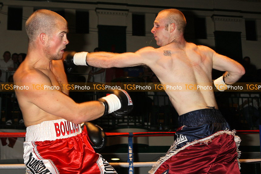 Gary Boulden (red shorts) defeats Stuart Tordoff in a Middleweight boxing contest at York Hall, Bethnal Green, promoted by Left Jab - 10/10/10 - MANDATORY CREDIT: Gavin Ellis/TGSPHOTO - Self billing applies where appropriate - Tel: 0845 094 6026