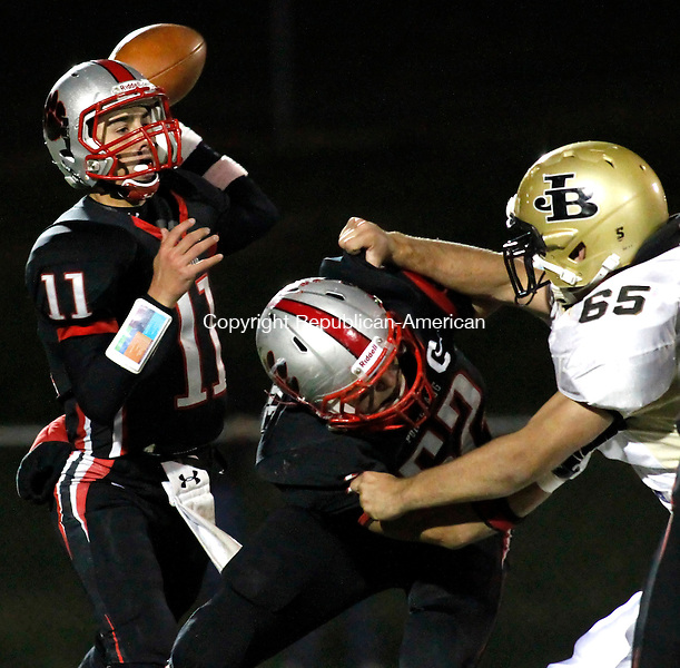 Southbury, CT- 29, October 2010-102910CM07  Pomperaug's Kellen Croce makes a pass  Friday night as teammate, Zachary Polke (#52) blocks  Joel Barlow's Jackson Sennett Friday night in Southbury. Pomperaug defeated Barlow, 44-13.   Christopher Massa Republican-American