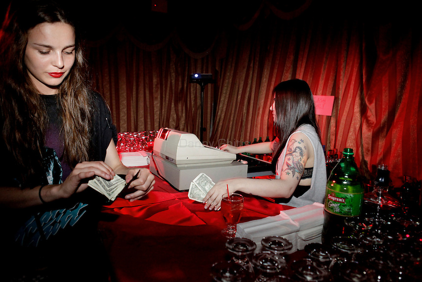Club-goers purchase drinks at an impromptu bar at Madam Wong night club.  By day Golden Unicorn is a traditional Chinese restaurant, but it is transformed into Madam Wong, a trendy Manhattan club at night. ..Danny Ghitis for The New York Times