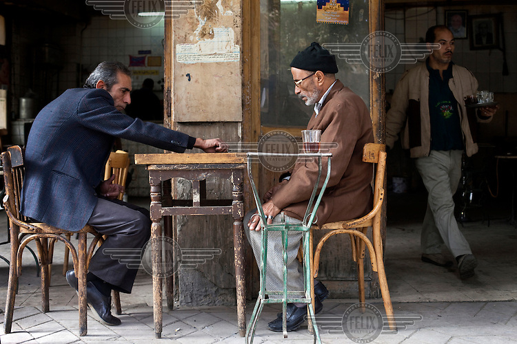 Men play backgammon outside a cafe on Hamid Farid Street in downtown Cairo. /Felix Features