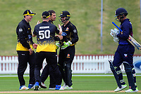 Malcolm Nofal celebrates dismissing Michael Barry (right) during the Ford trophy one day cricket match between Wellington Firebirds and Auckland Aces at the Basin Reserve in Wellington, New Zealand on Sunday, 4 November 2018. Photo: Dave Lintott / lintottphoto.co.nz