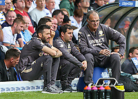 Leeds United manager Marcelo Bielsa and his staff watch on during the first half<br /> <br /> Photographer Alex Dodd/CameraSport<br /> <br /> The EFL Sky Bet Championship - Leeds United v Nottingham Forest - Saturday 10th August 2019 - Elland Road - Leeds<br /> <br /> World Copyright © 2019 CameraSport. All rights reserved. 43 Linden Ave. Countesthorpe. Leicester. England. LE8 5PG - Tel: +44 (0) 116 277 4147 - admin@camerasport.com - www.camerasport.com