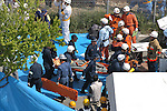 10th Anniversary File Photo: Rescue workers at the spot where a train that crashed into a building in Amagasaki, Japan on April 25, 2005. 107 people were killed in the accident, 562 were injured.<br /> <br /> The accident was Japan's most serious since a train accident in 1963 killed 162 people. (Photo by Duits.co/AFLO)