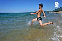 Boy (12) running into water on beach (Licence this image exclusively with Getty: http://www.gettyimages.com/detail/83154207 )