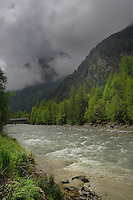 Low cloud over the mountains, fast flowing river between  the pastures and forests. Stuibenfall, ötztal, Tyrol, Tirol, Alps Austria,