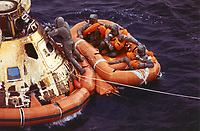 Hawaii, USA - 07/24/1969 File Photo - Pararescueman Lt. Clancy Hatleberg closes the Apollo 11 spacecraft hatch as astronauts Neil Armstrong, Michael Collins, and Buzz Aldrin, Jr., await helicopter pickup from their life raft. They splashed down at 12:50 pm EDT July 24, 1969, 900 miles southwest of Hawaii after asuccessful lunar landing mission.