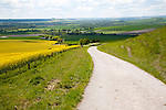 Small narrow lane on chalk downland scarp slope, Allington Down, Wiltshire, England