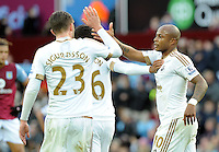 Andre Ayew of Swansea City celebrates his goal with Kyle Naughton of Swansea City during the Barclays Premier League match between Aston Villa v Swansea City played at the Villa Park Stadium, Birmingham on October 24th 2015