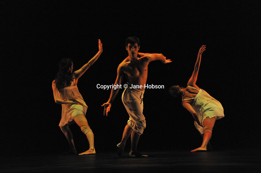 LONDON, UK. UK Premiere of 'AfterLight' by the Russell Malipahnt Company at Sadler's Wells. 28.9.10. Photograph by Jane Hobson. Dancers are Daniel Prioetto, Silvina Cortes, Olga Cobos. Director and Choreographer: Russell Maliphant. Lighting: Michale Hulls. Original Music: Andy Cowton. Piano music Gnossiennes 1 - 4 by Erik Satie performed by Dustin Gledhill. Costumes: Stevie Stuart. Animation: Jan Urbanowski and James Chorley. Original Design Concept: Michael Hulls with Es Devlin.