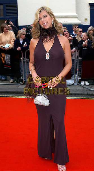 KATE GARRAWAY.Arrivals at the Pioneer British Academy Television Awards (TV BAFTA's).April 17th, 2005.full length silver purse feather collar boa brown dress.www.capitalpictures.com.sales@capitalpictures.com.© Capital Pictures.