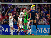 ORLANDO, FL - MARCH 05: Alyssa Naeher #1  of the United States comes out for the punch as Julie Ertz #8 heads the ball away during a game between England and USWNT at Exploria Stadium on March 05, 2020 in Orlando, Florida.