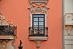 Iron balcony and elaborate window in Valencia, Spain