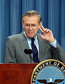 United States Secretary of Defense Donald Rumsfeld strains to hear a reporter's question at a press briefing at the Pentagon in Washington, DC to discuss the continuing anti-terrorist activities by the United States on October 9, 2001.<br /> Credit: Ron Sachs / CNP
