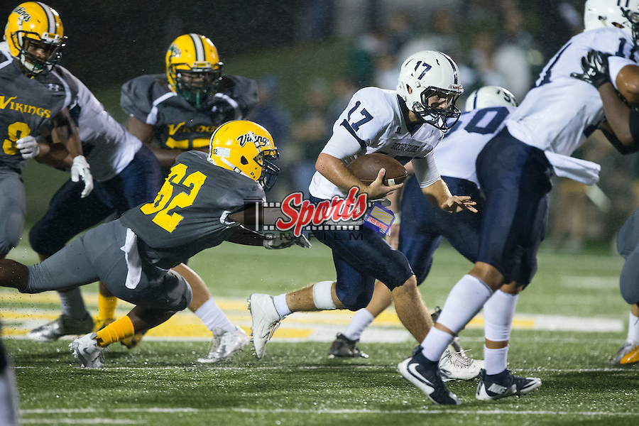 Khalil Spratt (62) of the Central Cabarrus Vikings tries to tackle Greg Waslo (17) of the Hickory Ridge Ragin' Bulls during first half action at Central Cabarrus High School on September 25, 2015 in Concord, North Carolina.  The Ragin' Bulls defeated the Vikings 41-12.  (Brian Westerholt/Sports On Film)