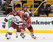 Dave MacDonald (Harvard - 14), Randy Guzior (NU - 13) - The Northeastern University Huskies defeated the Harvard University Crimson 3-1 in the Beanpot consolation game on Monday, February 12, 2007, at TD Banknorth Garden in Boston, Massachusetts.