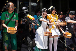 A cosplayer and maid cafe waitresses sprinkle water during the ''Uchimizukko Big Gathering Festival'' in Akihabara electric district of Tokyo, Japan on August 23, 2015. About 21 groups from Akihabara including maid cafes' waitresses and cosplayers attended the event, which included for the first time an official mascot character ''2C Chan.'' This year is the 12th anniversary of the event which began as a way to reduce dust and cool pavements in the Akihabara area. Uchimizukko is a Japanese summer tradition. (Photo by Rodrigo Reyes Marin/AFLO)