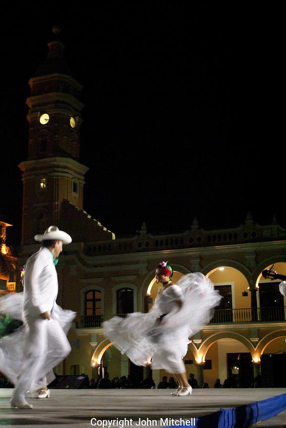 Twirling folk dancers performing the traditional Los Pescadores dance in the Plaza de Armas, Veracruz, Mexico