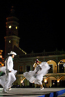 Twirling folk dancers performing the traditional Los Pescadores dance in the Plaza de Armas, Veracruz, Mexico