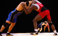 11 DEC 2011 - LONDON, GBR - Ibrahim Bolukbasi (TUR) (in red) and Maciej Balawender (POL) (in blue) wrestle for bronze during their men's 84kg bout at the London International Wrestling Invitational and 2012 Olympic Games test event at the ExCel Exhibition Centre in London, Great Britain (PHOTO (C) NIGEL FARROW)