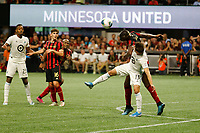 ATLANTA, Georgia - August 27: Ethan Finlay #13 and Florentin Pogba #4 during the 2019 U.S. Open Cup Final between Atlanta United and Minnesota United at Mercedes-Benz Stadium on August 27, 2019 in Atlanta, Georgia.