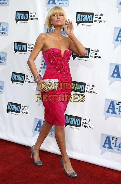 "PARIS HILTON .Bravo's 2nd Annual ""The A-List Awards"" held at The Orpheum Theatre, Los Angeles, CA, USA, 5th April 2009..full length strapless pink dress silver crystals jewelled shoes grey gray clutch bag hand bracelets .CAP/ADM/MJ.©Michael Jade/Admedia/Capital Pictures"