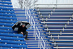 SIOUX FALLS, SD - NOVEMBER 3: A fan tries to keep dry and warm during the South Dakota State game against  Missouri State Saturday afternoon at Dana J. Dykhouse Stadium in Brookings. (Photo by Dave Eggen/Inertia)