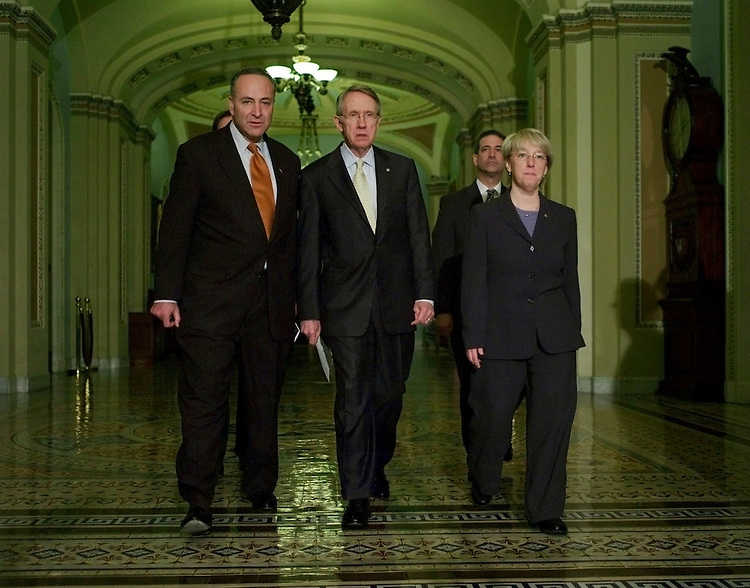 03/08/07--Senate DSCC Chairman Charles E. Schumer, D-N.Y., Senate Majority Leader Harry Reid, D-Nev., Sen. Russ Feingold, D-Wis., and Senate Democratic Conference Secretary Patty Murray, D-Wash., arrive for a news conference introducing a joint resolution outlining a limited new mission for U.S. troops in Iraq and setting a goal of removing them by March 31, 2008. The resolution also establishes a target date for a pullout of combat troops Ñ favored by liberal senators Ñ but only as a goal, easing the fears of some moderate senators who have opposed a hard withdrawal date. Debate could begin as soon as Tuesday Majority Leader Sen. Harry Reid, D-Nev., said. Yet it is not clear if it can obtain enough support to cross the 60-vote threshhold needed to block a filibuster on the measure. Democratic leaders said they would allow three Republican amendments: one by Sen. Judd Gregg, R-N.H., barring war funding cuts that would undermine the safety or the mission of troops in the field, a modified version of an earlier resolution (S 470) by Sen. John W. Warner, R-Va., disagreeing with BushÕs decision to send additional troops to Iraq, and a third offered by Sen. John McCain, R-Ariz., setting benchmarks for the Iraqi government. House Democratic leaders earlier introduced a plan to set an ultimate deadline of August 2008 for removing troops from combat in Iraq and would require the president to certify by July that Iraqis are meeting key political benchmarks. Congressional Quarterly Photo by Scott J. Ferrell