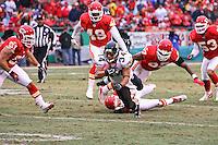 Chiefs long snapper Kendall Gammon (bottom) trips up Jacksonville Jaguars kick returner Alvin Pearman on a 17 yard punt return in the first half at Arrowhead Stadium in Kansas City, Missouri on December 31, 2006. The Chiefs won 35-30.