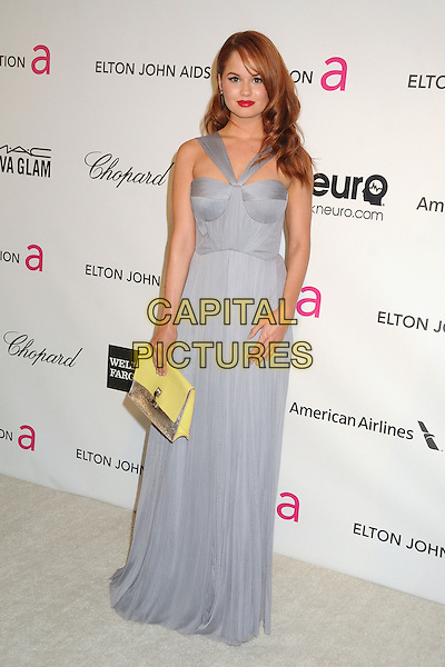 Debby Ryan.21st Annual Elton John Academy Awards Viewing Party held at West Hollywood Park, West Hollywood, California, USA..February 24th, 2013.oscars full length dress blue sheer silver yellow clutch bag.CAP/ADM/BP.©Byron Purvis/AdMedia/Capital Pictures.