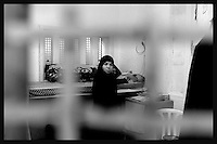 An unidentified woman is seen in the Islamic movements prisoners wing at Hasharon Israeli prison...75 female Palestinian prisoners are kept in a special wing at Hasharon prison next to Netanyah. The women's wing of the prison is divided between prisoners members of Fatah movement located in one floor and on the other floor members of Hamas and Islamic Jihad. Photo by Quique Kierszenbaum..