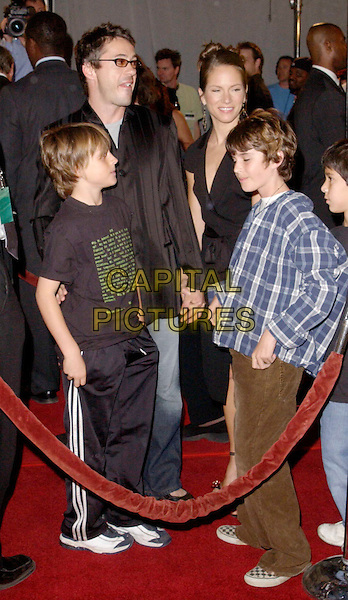 ROBERT DOWNEY JR. & SON.attends the Warner Brothers L.A. Premiere of The Matrix Revolutions held at The Walt Disney Concert Hall. .full length, full-length.www.capitalpictures.com.sales@capitalpictures.com.©Capital Pictures.