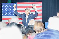 Former Secretary of State John Kerry arrives to speak at a campaign event for Democratic presidential candidate and former Vice President Joe Biden at The Sports Barn in Hampton, New Hampshire, on Sun., December 8, 2019.