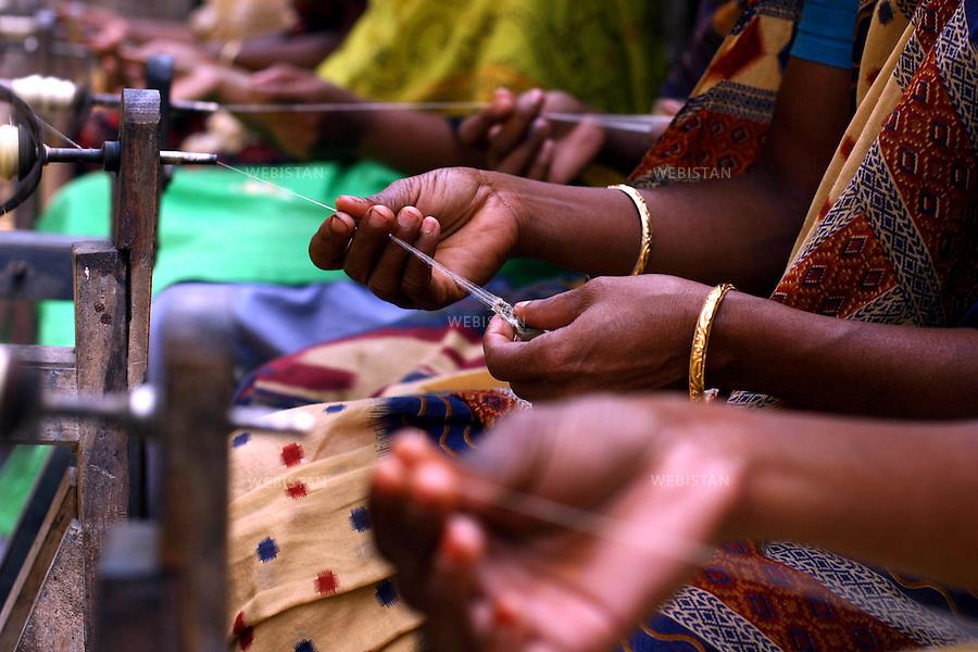 """Bangladesh. Women spin the fine silk thread from the cocoons..They are then dried in bunches called """"lasi"""". ..Bangladesh. Des femmes filent les fins fils de soie à partir des cocons. Ils sont ensuite séchés en paquets appelés """"lasi"""""""
