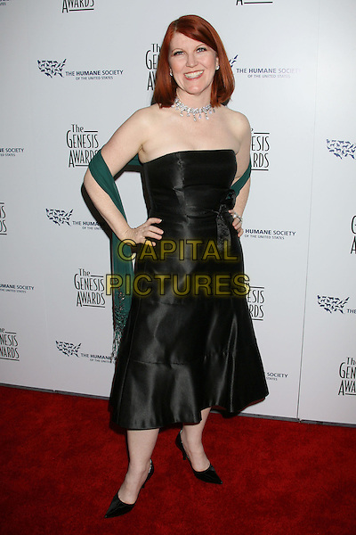 KATE FLANNERY .22nd Annual Genesis Awards held at the Beverly Hilton Hotel,  Beverly Hills, California, USA,  29 March 2008..full length strapless black dress green wrap hand on hip .CAP/ADM/RE.©Russ Elliot/Admedia/Capital PIctures