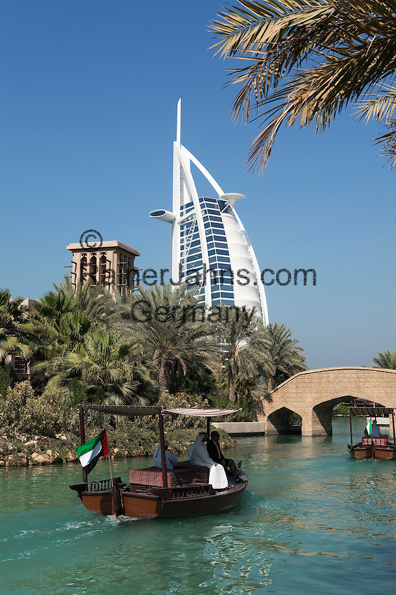 United Arab Emirates, Dubai: Abra tour on the waterways of the Madinat Jumeriah with the Burj al Arab in the background