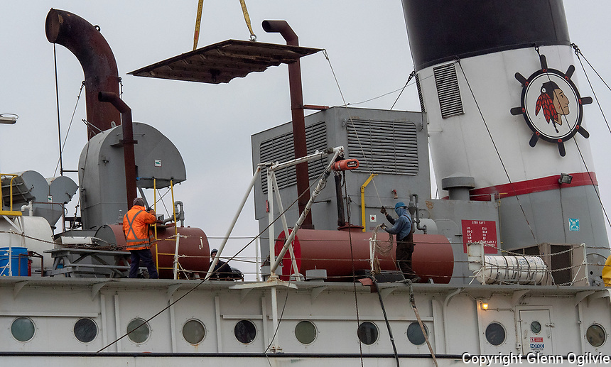 Central Machine and Marine workers guide a steel plate aboard the Lower Lakes Towing Ltd., lake freighter Mississagi. The ship iOS berthed at the North Slip Dock and is in port for repairs.