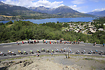 The peloton led by Team Sky start to climb Cote de Demoiselles Coiffees at Lac de Serre-Poncon during Stage 18 of the 104th edition of the Tour de France 2017, running 179.5km from Briancon to the summit of Col d'Izoard, France. 20th July 2017.<br /> Picture: Eoin Clarke | Cyclefile<br /> <br /> All photos usage must carry mandatory copyright credit (&copy; Cyclefile | Eoin Clarke)
