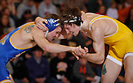SPEARFISH, S.D. -- Dustin Walraven, left, of South Dakota State ties up with Brandon Richardson of the University of Wyoming during their 149 lb. match Sunday afternoon at the Young Center in Spearfish, S.D.  (Photo by Richard Carlson/Inertia via dakotapress.org)