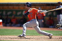 OAKLAND, CA - MAY 9:  Alex Bregman #2 of the Houston Astros bats against the Oakland Athletics during the game at the Oakland Coliseum on Wednesday, May 9, 2018 in Oakland, California. (Photo by Brad Mangin)
