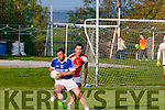 Mikey Boyle, Shannon Rangers tries to round Rathmore's full back Tom O'Sullivan when the sides met in Tarbert last Saturday evening