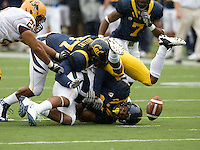 California's Robert Mullins and C.J. Moncrease tackle Kyle Middlebrooks of ASU during kick-off at Memorial Stadium in Berkeley, California on October 23rd, 2010.  California defeated Arizona State, 50-17.